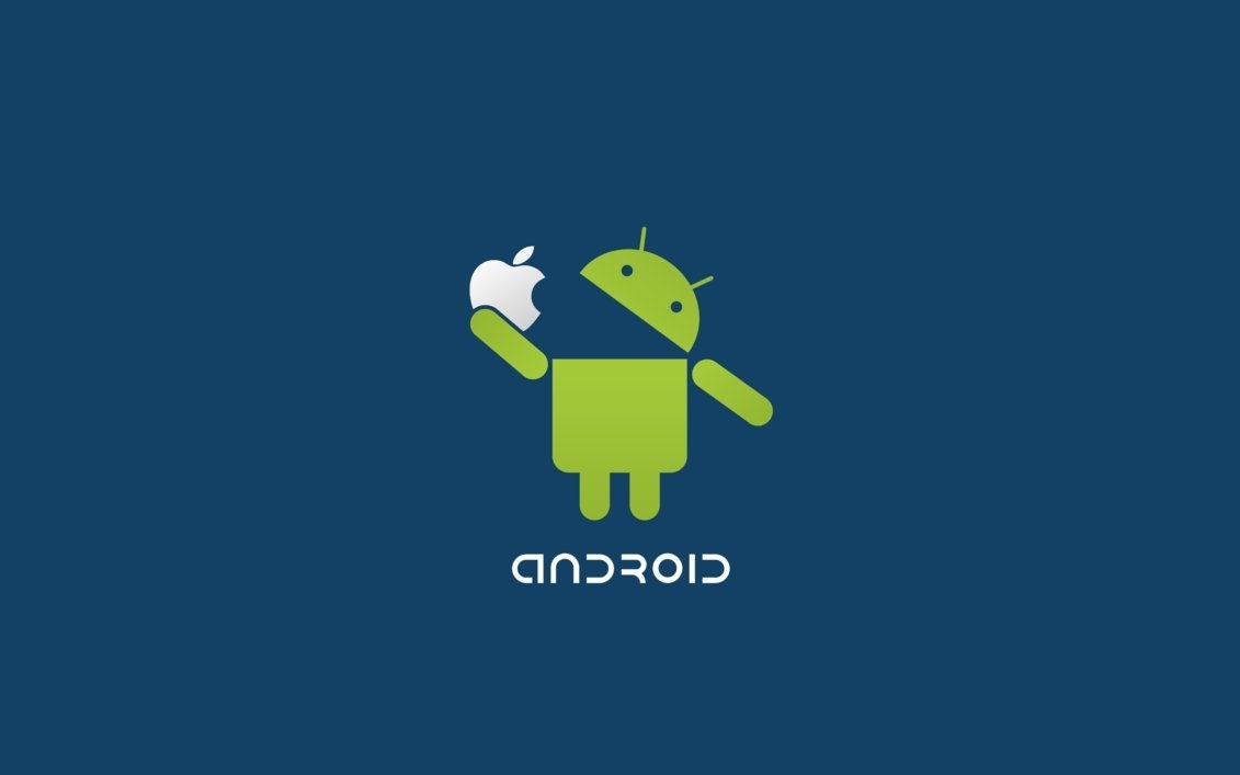 comparative - android's logo is eating apple's logo to represent